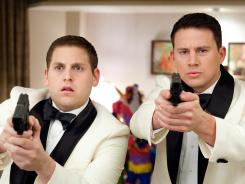 Jonah Hill, left, and Channing Tatum go gunning for a drug ring in high school in '21 Jump Street.'