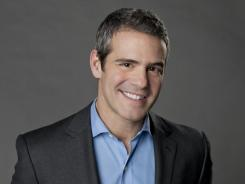 Andy Cohen read 'The Hunger Games' during a flight from L.A. to New York and fell in love with the book.