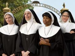 In the habit: Kate Upton, left, Jane Lynch, Jennifer Hudson, Larry David star as nuns who raise the title characters in 'The Three Stooges.'