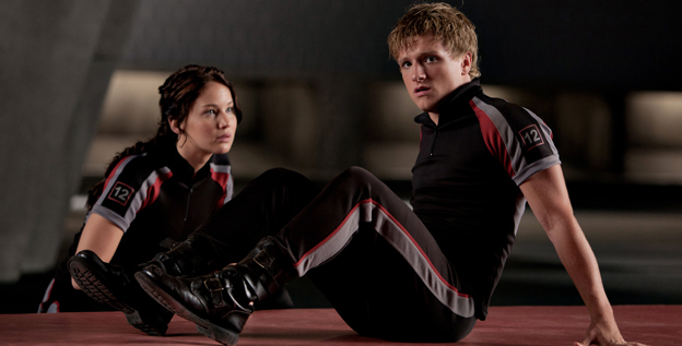 Katniss Everdeen (Jennifer Lawrence) and Peeta Mellark (Josh Hutcherson) prepare for battle in 'The Hunger Games,' one of the most highly anticipated films of 2012.