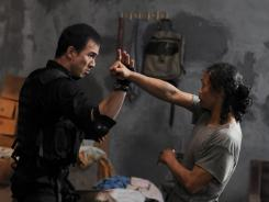 Joe Taslim, left, and Yayan Ruhian battle in 'The Raid: Redemption,' an Indonesian action film opening Friday in select cities.
