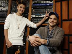 """Punking the punker: Ashton Kutcher, right, says to 'Punk'd' guest host Justin Bieber, """"Are you giving me rabbit ears and I'm not knowing it?"""""""