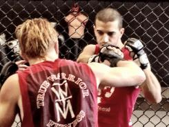 All aboard the pain (cross) train: Ballas likes to shock his system with MMA workouts. Here, he works out with trainer Toby Grear.