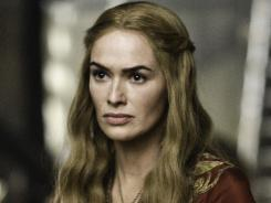 "Icy queen: Lena Headey plays Queen Cersei. Headey says the show's women ""are fascinating, admirable, frightening. They possess all qualities of a being, whether it be a man or whatever."" Season 2 premieres Sunday at 9 p.m. ET on HBO."