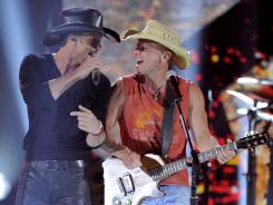 Superstar pairing: Tim McGraw and Kenny Chesney perform at Sunday's Academy of Country Music Awards.
