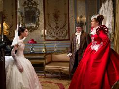 Family feud: Snow White (Lily Collins) faces off with her stepmother, the evil queen (Julia Roberts), who mistreats everyone, including her servant Brighton (Nathan Lane).