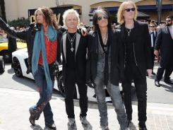 Steven Tyler, left, Joey Kramer, Joe Perry, and Tom Hamilton of Aerosmith will hit the concert road in June.