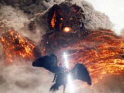 Too hot to handle: Perseus (Sam Worthington) battles the lava-fueled Kronos in 'Wrath of the Titans.'