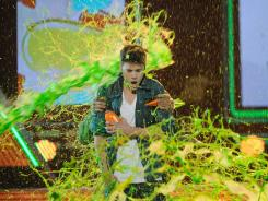 Bieber accepts the Favorite Singer award onstage at Nickelodeon's 25th Annual Kids' Choice Awards in Los Angeles.