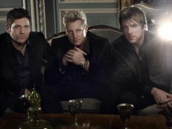 Rascal Flatts: The trio — Jay Demarcus, left, Gary LeVox and Joe Don Rooney — has streamlined its mix of pop and country in 'Changed.'