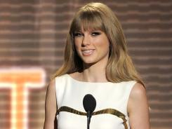 Taylor Swift presents the award for male vocalist of the year at the 47th Annual Academy of Country Music Awards on Sunday in Las Vegas.