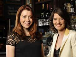 Art imitates life: Alyson Hannigan, left, and Cobie Smulders of 'How I Met Your Mother' are both moms in real life.