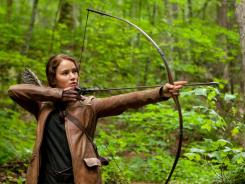 "Survival is her target: In 'The Hunger Games,' Katniss relies on her bow, which Jennifer Lawrence says is ""way cooler"" than a gun."