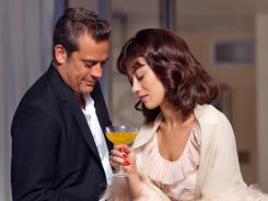"Jeffrey Dean Morgan and Olga Kurylenko star in Magic City. Creator Mitch Glazer says the series is ""like Spartacus with Jews. Intrigue and sex and betrayal."""
