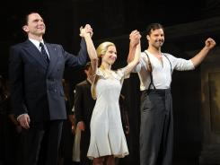 Michael Cerveris, left, is Argentinian leader Juan Peron, Elena Roger is his wife, Eva, and Ricky Martin is narrator Che in the new Broadway production of 'Evita.'