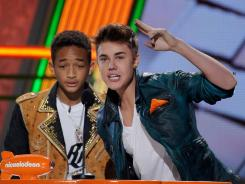 Social media make it easier to contact celebrities such as Justin Bieber, right, and Jaden Smith, left, and ask for a date.