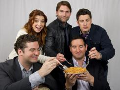 This tastes familiar: American Reunion writers and directors Jon Hurwitz and Hayden Schlossberg (front) with cast members Alyson Hannigan, Seann William Scott and Jason Biggs.