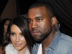 Close at Paris Fashion Week:  Kim Kardashian and Kanye West.