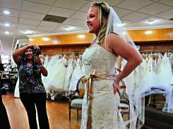 Pinterest bride:  Trish Smith tries on a wedding dress she found online via Pinterest at Mary Me Bridal in Orange, Calif., as mom Phyllis Smith takes a snapshot. Her wedding is set for November.