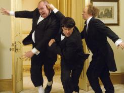 Will Sasso, left, Chris Diamantopoulos and Sean Hayes assume the mantle of Curly, Moe and Larry in 'The Three Stooges,' out Friday.