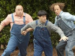 Will Sasso, left, Chris Diamantopoulos and Sean Hayes resurrect 'The Three Stooges' as Curly, Moe and Larry.