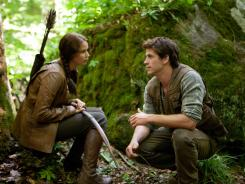 'The Hunger Games,' with Jennifer Lawrence and Liam Hemsworth, is the first film to top the box office for four consecutive weeks since 'Avatar.'