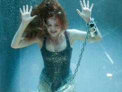Can't keep a good woman down: Isla Fisher is the group's escape artist.