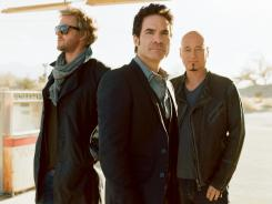 Train (Scott Underwood, left, Pat Monahan and Jimmy Stafford) has released its sixth album, 'California 37,' which is full of buoyant melodies.