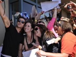 Girls gone wild: Former teen heartthrob Zac Efron mixes with his key demographic at Camp Pendleton as he promotes his film 'The Lucky One,' about a Marine home from war searching for the woman he believes was his good luck charm.