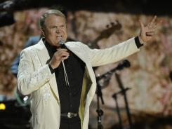 Glen Campbell, seen here at this year's Grammys, is currently on tour in part to pay overdue taxes.