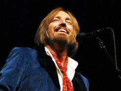 All five of Tom Petty's valuable guitars have been recovered, and a security guard is under arrest for their theft.