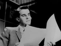Dick Clark looks over some papers during an 'American Bandstand' show in Philadelphia.