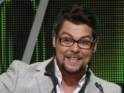 Gospel singer Jason Crabb was named artist of the year and male artist of the year at Thursday's Dove Awards in Atlanta.