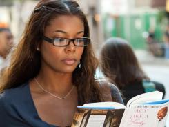 Kristen (Gabrielle Union) reads Steve Harvey's book in a scene from 'Think Like a Man.'