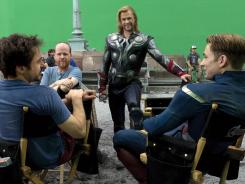 Robert Downey Jr., left, Joss Whedon, Chris Hemsworth and Chris Evans share some laughs on the set of 'The Avengers.'