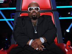 CeeLo watched members of his team, along with Adam's, sing for survival on Tuesday's 'The Voice.'