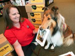 Volunteering his tail off: Jonah, a collie certified as a R.E.A.D.  Reading Education Assistance Dog  will help owner Amy Skeels, who chose Because of Winn-Dixie to deliver to students in North Kansas City, Mo.