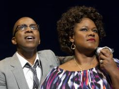 Leslie Odom, Jr., left, and Kecia Lewis-Evans are part of the appealing cast of 'Leap of Faith,' now playing at the St. James Theatre in New York.