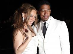 Mariah Carey, left, and Nick Cannon pose Friday in Paris, where they renewed their wedding vows.