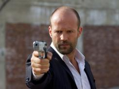 Action abounds: Jason Statham takes on Triads, the Russian Mob and corrupt cops while protecting a talented young girl in 'Safe.'