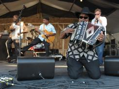 Nathan Williams, on accordion, and the Zydeco Cha Chas get down to business on the Sheraton New Orleans Fais Do-Do Stage.
