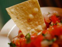 Tomatoes, cilantro, jalapenos, and Serrano are common ingredients in Mexican salsa.