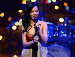 Rihanna joins host Eli Manning on 'Saturday Night Live.' It marks the R&B star's third performance on the show.