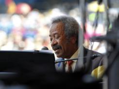 Allen Toussaint performs Saturday at the New Orleans Jazz and Heritage Festival.
