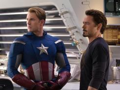 Robert Downey Jr., right, will reprise his role as Tony Stark in 'Iron Man 3' in May 2013, while Chris Evans will return for his second solo film as Captain America in April 2014.