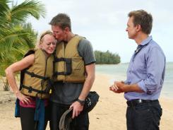 Army of two: Military couple Rachel and Dave get the good news from Phil Keoghan that they've won 'The Amazing Race.'