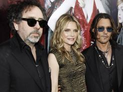Director Tim Burton, Michell Pfeiffer and Johnny Depp pose at premiere for 'Dark Shadows,' out Friday.