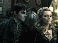 Back from the undead: Johnny Depp stars as vampire Barnabus Collins, with Michelle Pfeiffer as Elizabeth Collins Stoddard, in Tim Burton's 'Dark Shadows,' based upon cult classic soap opera.