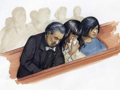 In this courtroom sketch, singer and actress Jennifer Hudson, center, along with her fiance David Otunga, and sister Julia Hudson react in court in Chicago on Friday.