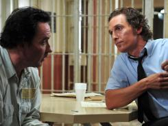 A journalist (Matthew McConaughey, right) tries to clear the name of a death row inmate (John Cusack) in 'The Paperboy.'